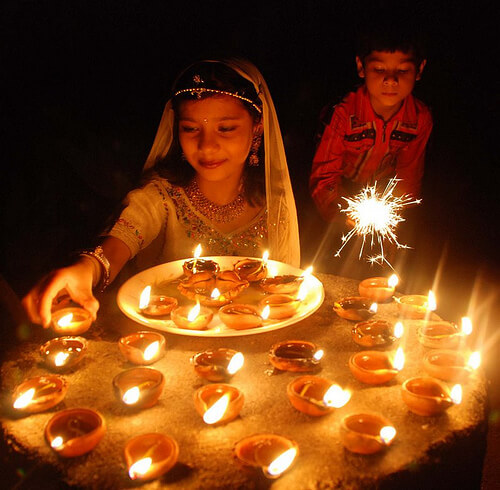 diwali-kids-lighting-lamps